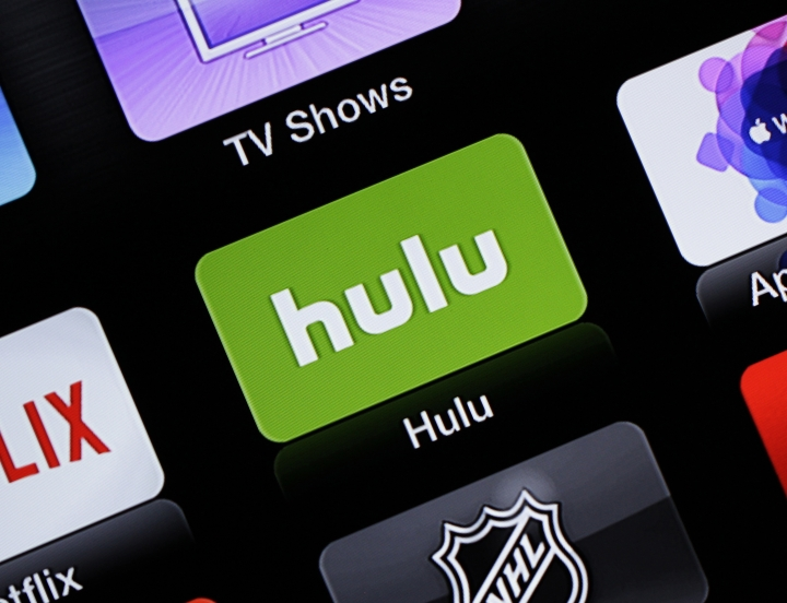 FILE- This June 24, 2015, file photo shows the Hulu Apple TV app icon in South Orange, N.J. Hulu's live-TV streaming service will cost $5 more per month, while its traditional video-on-demand service will be $2 cheaper. Hulu with Live TV, a cable-like package with ESPN and a few dozen other channels, will cost $45 a month starting Feb. 26, 2019. (AP Photo/Dan Goodman, File)