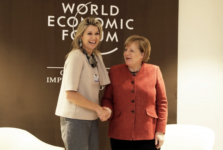 German Chancellor Angela Merkel meets with Queen Maxima of the Netherlands, left, at the annual meeting of the World Economic Forum in Davos, Switzerland, Wednesday, Jan. 23, 2019. (AP Photo/Markus Schreiber)