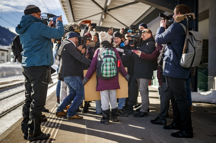 16 year-old Swedish climate activist Greta Thunberg is surrounded by journalists as she arrives to attend the 49th Annual Meeting of the World Economic Forum, WEF, in Davos, Switzerland, Wednesday, Jan. 23, 2019. (Valentin Flauraud/Keystone via AP)
