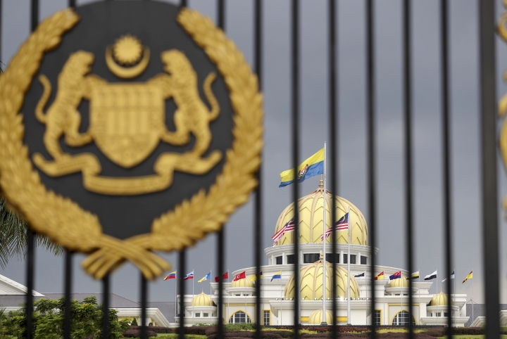 Malaysia National Palace is pictured through the front entrance in Kuala Lumpur, Malaysia, Thursday, Jan. 24, 2019. King Sultan Muhammad V shocked the nation by announcing his abdication in January 2019, days after returning from two months of medical leave. The 49-year-old sultan from eastern Kelantan state only reigned for two years as Malaysia's 15th king and didn't give any reason for quitting. Sultan Abdullah Azlan Shah succeeded his ailing 88-year-old father on Jan. 15, in a move seen as paving the way for him to become the next king. (AP Photo/Vincent Thian)