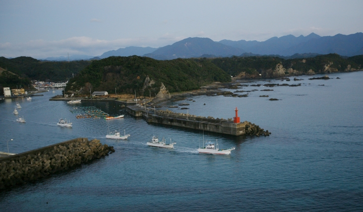 FILE - In this Jan. 29, 2008, file photo, fleet of fishing boats leave Taiji port, in Japan for a day of fishing. Japanese whalers are discussing plans ahead of their July 1, 2019 resumption of commercial hunting along the northeastern coasts for the first time in three decades. (AP Photo/Junji Kurokawa, File)