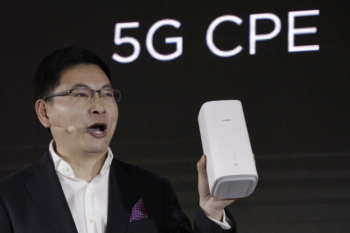 Richard Yu, CEO of the Huawei consumer business group speaks as he unveils the wireless router running with 5G modem Balong 5000 chipset in Beijing, Thursday, Jan. 24, 2019. Chinese tech giant Huawei has announced plans to release a next-generation smartphone based on its own technology instead of U.S. components, stepping up efforts to compete with global industry leaders. (AP Photo/Andy Wong)