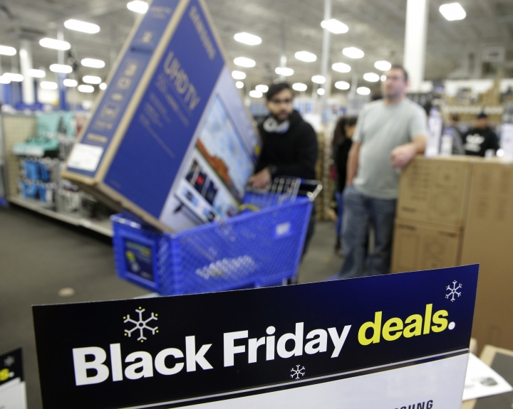 FILE- In this Nov. 22, 2018, file photo people wait in line to buy televisions as they shop during an early Black Friday sale at a Best Buy store on Thanksgiving Day in Overland Park, Kan. The holiday season was a brutal one for U.S. retailers, especially department stores and companies that sell luxury products. (AP Photo/Charlie Riedel, File)