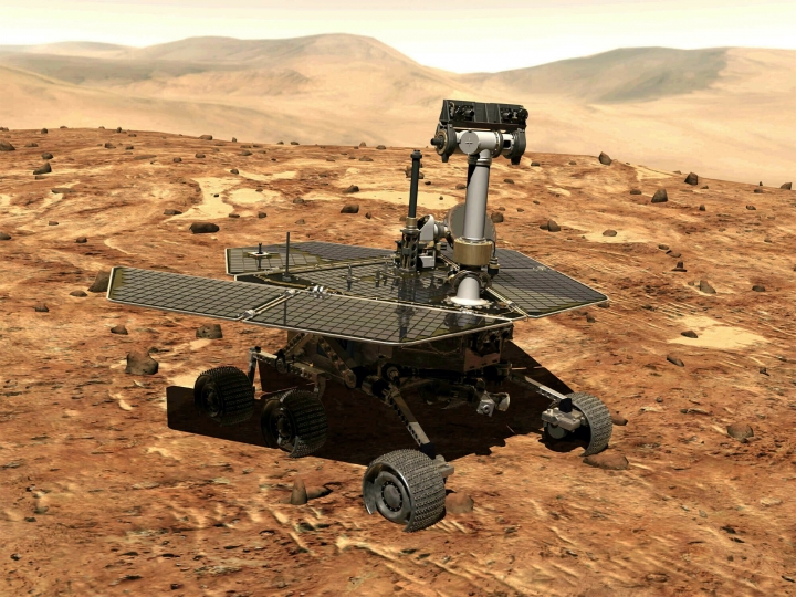FILE - This illustration made available by NASA shows the rover Opportunity on the surface of Mars. The exploratory vehicle landed on Jan. 24, 2004, and logged more than 28 miles (45 kilometers) before falling silent during a global dust storm June 2018. There was so much dust in the Martian atmosphere that sunlight could not reach Opportunity's solar panels for power generation. (NASA via AP)