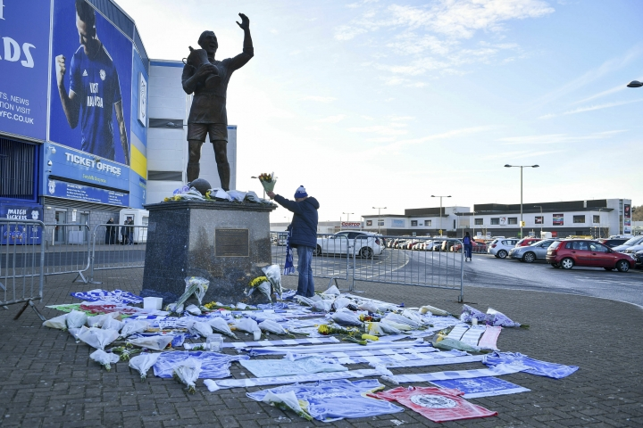 Flowers and tributes are placed near the statue of Cardiff City footballer Frederick Charles Keenor outside Cardiff City Football Club, Wales, Wednesday Jan. 23, 2019, after a plane with new signing Emiliano Sala on board went missing over the English Channel on Monday night. The search resumed Wednesday to find missing Emiliano Sala and his pilot with authorities in the Channel Islands prioritizing whether they have been unable to make contact after more than 36 hours having managed to land, been picked up by a ship or are still on a lifeboat. (Ben Birchall/PA via AP)