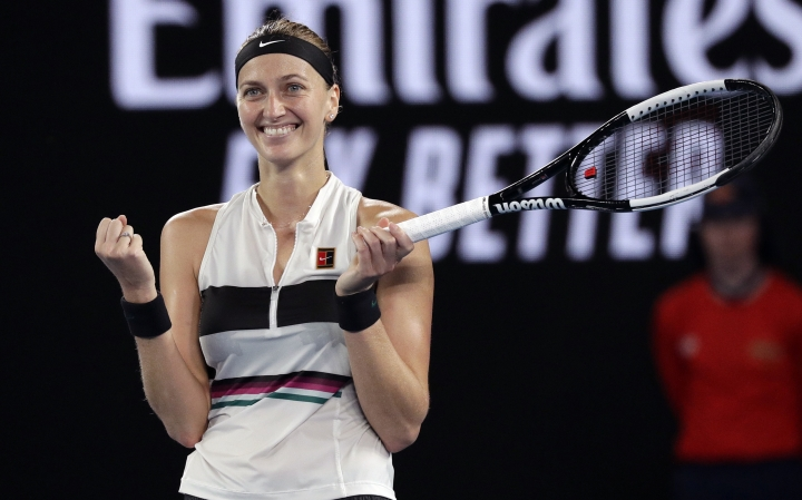 Petra Kvitova of the Czech Republic celebrates after defeating United States' Danielle Collins in their semifinal at the Australian Open tennis championships in Melbourne, Australia, Thursday, Jan. 24, 2019. (AP Photo/Kin Cheung)