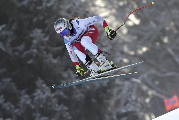 Switzerland's Corinne Suter is airborne during an alpine ski, women's World Cup downhill training, in Garmisch Partenkirchen, Germany, Friday, Jan. 25, 2019. (AP Photo/Marco Tacca)