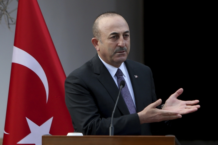 Turkish Foreign Minister Mevlut Cavusoglu talks to the media after a meeting with and Turkish Cypriot leader Mustafa Akinci in the Turkish Cypriot breakaway north part of the divided capital Nicosia, Cyprus, Friday Jan. 25, 2019. Cavusoglu is in Turkish breakaway north part of the divided island for talks in two-day visit. (AP Photo/Petros Karadjias)