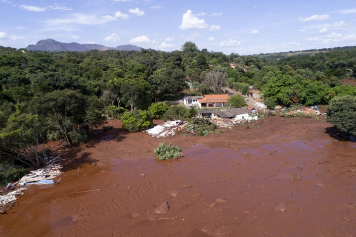 An aerial view shows flooding triggered by a collapsed dam near Brumadinho, Brazil, Friday, Jan. 25, 2019. Brazilian mining company Vale SA said it didn't yet have information on deaths or injuries at the dam but said that tailings have reached the community of Vila Ferteco. (Bruno Correia/Nitro via AP)