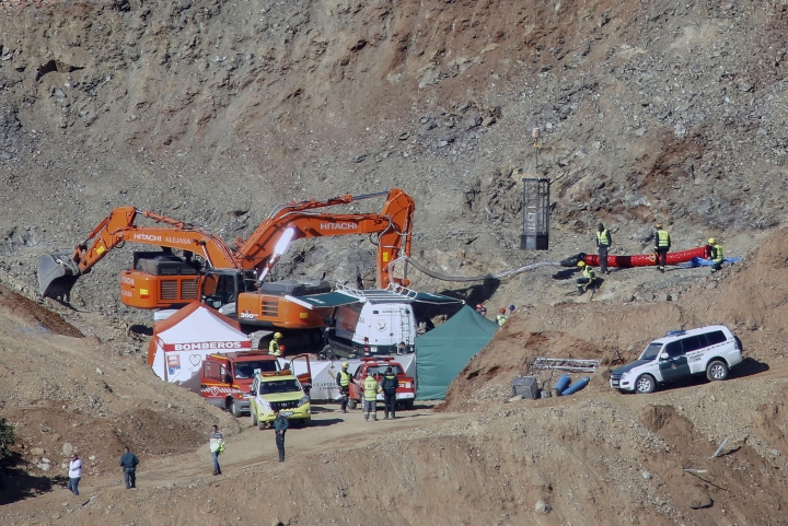 In this photo taken on Thursday, Jan. 24, 2019, drill and excavating machinery work on top of the mountain next to a deep borehole to reach a 2-year-old boy trapped there for twelve days near the town of Totalan in Malaga, Spain. Spanish authorities say that rescue experts are using explosives to make their way through a 4-meter (13-foot) wall of hard rock to reach the space where a 2-year-old boy has been trapped for 12 days. (Alex Zea/Europa Press via AP)