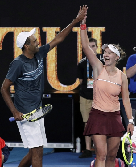 Barbora Krejcikova of the Czech Republic and United States' Rajeev Ram celebrate after defeating Australia's Astra Sharma and compatriot John-Patrick Smith in the mixed doubles final at the Australian Open tennis championships in Melbourne, Australia, early Sunday, Jan. 27, 2019. (AP Photo/Aaron Favila)