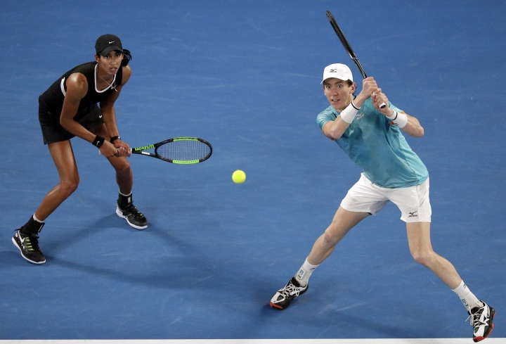 Australia's Astra Sharma and compatriot John-Patrick Smith during the mixed doubles final against Barbora Krejcikova of the Czech Republic and United States' Rajeev Ram at the Australian Open tennis championships in Melbourne, Australia, Saturday, Jan. 26, 2019. (AP Photo/Kin Cheung)