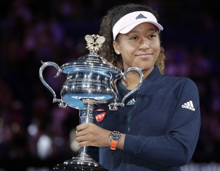 Japan's Naomi Osaka poses with her trophy after defeating Petra Kvitova of the Czech Republic in the women's singles final at the Australian Open tennis championships in Melbourne, Australia, Saturday, Jan. 26, 2019. (AP Photo/Aaron Favila)