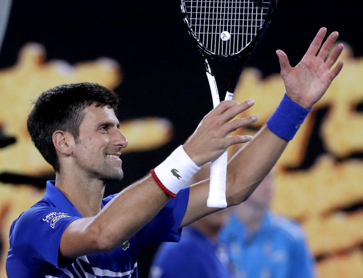 Serbia's Novak Djokovic celebrates after defeating France's Lucas Pouille in their semifinal at the Australian Open tennis championships in Melbourne, Australia, Friday, Jan. 25, 2019. (AP Photo/Mark Schiefelbein)