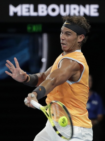 Spain's Rafael Nadal makes a forehand return to Greece's Stefanos Tsitsipas during their semifinal at the Australian Open tennis championships in Melbourne, Australia, Thursday, Jan. 24, 2019. (AP Photo/Aaron Favila)