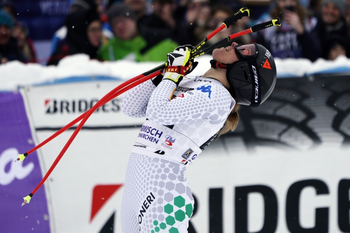 Italy's Sofia Goggia arrives at the finish area of an alpine ski, women's World Cup super G, in Garmisch Partenkirchen, Germany, Saturday Jan. 26, 2019. (AP Photo/Giovanni Auletta)