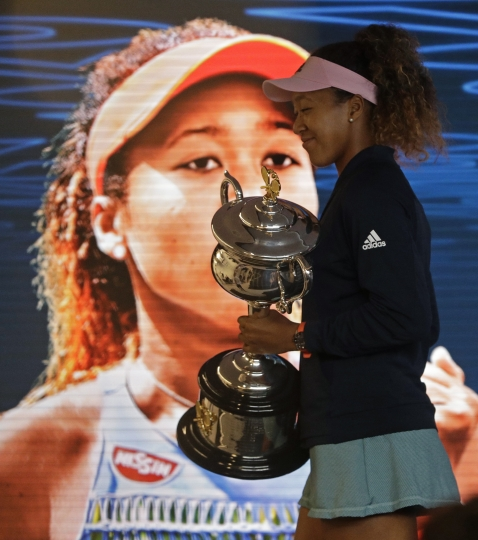 Japan's Naomi Osaka answers questions at a press conference after defeating Petra Kvitova of the Czech Republic in the women's singles final at the Australian Open tennis championships in Melbourne, Australia, early Sunday, Jan. 27, 2019. (AP Photo/Mark Schiefelbein)
