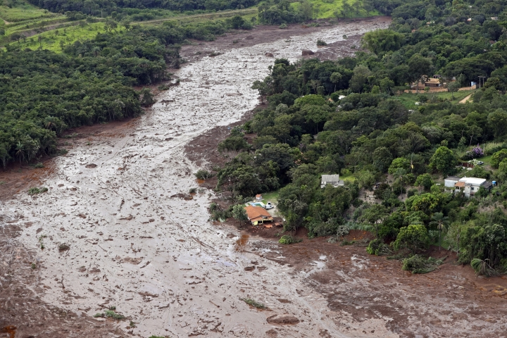 An aerial view shows a partially destroyed house after a dam collapsed in Brumadinho, Brazil, Saturday, Jan. 26, 2019. Rescuers searched for survivors in a huge area in southeastern Brazil buried by mud from the collapse of dam holding back mine waste, with several people dead and hundreds missing. (AP Photo/Andre Penner)