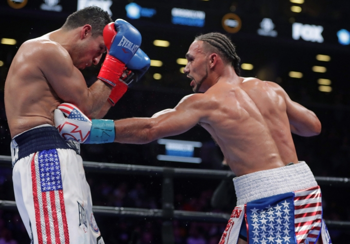 Keith Thurman, right, punches Josesito Lopez during the ninth round of a welterweight championship boxing match Saturday, Jan. 26, 2019, in New York. Thurman won the fight. (AP Photo/Frank Franklin II)