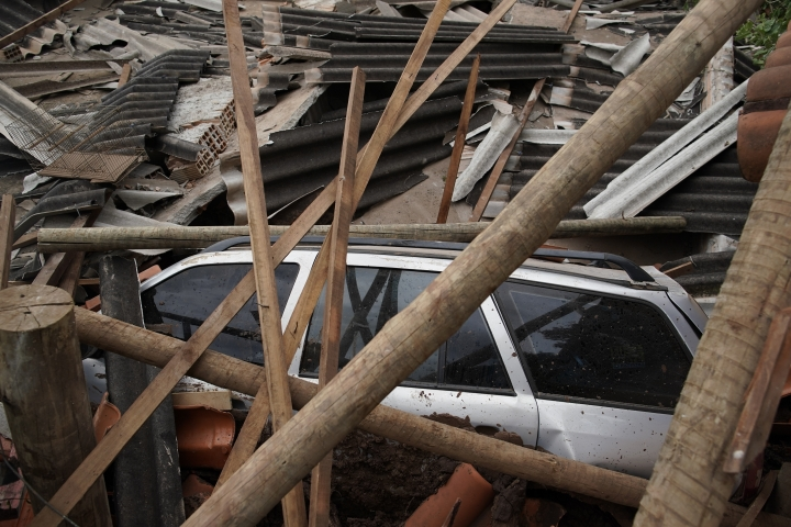 A car lies covered in debris after a dam collapse near Brumadinho, Brazil, Saturday, Jan. 26, 2019. Rescuers in helicopters on Saturday searched for survivors while firefighters dug through mud in a huge area in southeastern Brazil buried by the collapse of a dam holding back mine waste, with at least nine people dead and up to 300 missing. (AP Photo/Leo Correa)