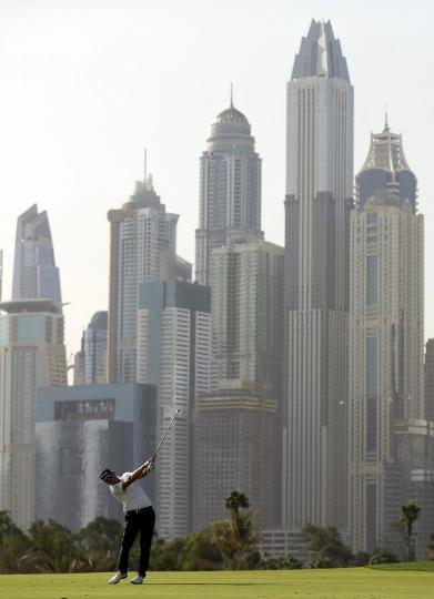 Matt Wallace of England plays a shot on the 13th hole during round three of the Dubai Desert Classic golf tournament in Dubai, United Arab Emirates, Saturday, Jan. 26, 2019. (AP Photo/Kamran Jebreili)