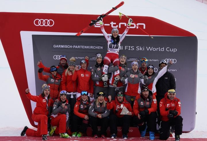 Winner Austria's Stephanie Venier celebrates with her team after completing an alpine ski, women's World Cup downhill race in Garmisch-Partenkirchen, Germany, Sunday, Jan. 27, 2019. (AP Photo/Giovanni Auletta)