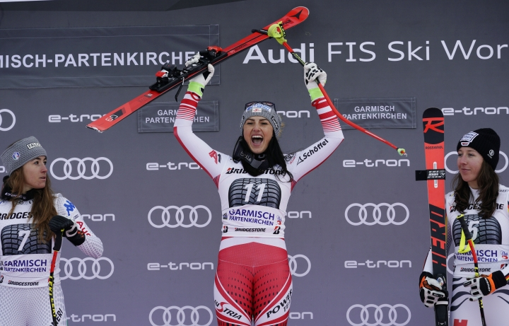 From left, second placed Italy's Sofia Goggia, the winner Austria's Stephanie Venier, and third placed Germany's Kira Weidle celebrate on podium after completing an alpine ski, women's World Cup downhill race in Garmisch-Partenkirchen, Germany, Sunday, Jan. 27, 2019. (AP Photo/Giovanni Auletta)