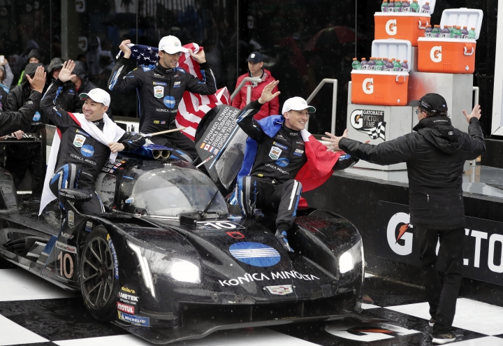 Car owner Wayne Taylor, far right, celebrates with drivers, from left, Kamui Kobayashi, of Japan, Jordan Taylor and Renger Van Der Zande, of the Netherlands, as Fernando Alonso, of Spain, drives the car to victory lane after winning the IMSA 24-hour race at Daytona International Speedway, Sunday, Jan. 27, 2019, in Daytona Beach, Fla. (AP Photo/John Raoux)