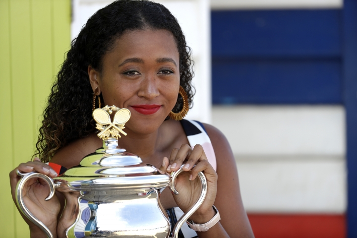 Japan's Naomi Osaka poses with her trophy the Daphne Akhurst Memorial Cup at Melbourne's Brighton Beach following her win over Petra Kvitova of the Czech Republic in the women's singles final at the Australian Open tennis championships in Melbourne, Australia, Sunday, Jan. 27, 2019. (AP Photo/Aaron Favila)