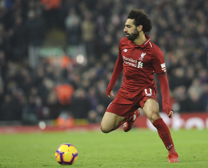 Liverpool's Mohamed Salah controls the ball during the English Premier League soccer match between Liverpool and Crystal Palace at Anfield in Liverpool, England, Saturday, Jan. 19, 2019. (AP Photo/Rui Vieira)