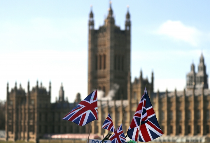 British Union flags fly in front of The Houses of Parliament in London, Tuesday, Jan. 22, 2019. British Prime Minister Theresa May launched a mission to resuscitate her rejected European Union Brexit divorce deal, setting out plans to get it approved by Parliament. (AP Photo/Frank Augstein)