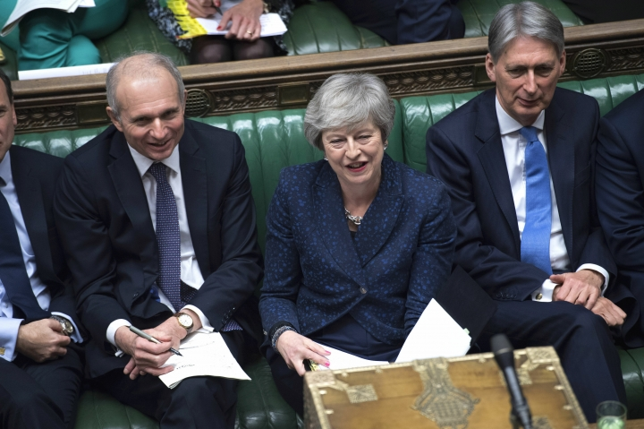 Britain's Cabinet Office Minister David Lidington, Prime Minister Theresa May and Chancellor Philip Hammond sit during Prime Minister's Questions in the House of Commons, London, Wednesday, Jan. 23, 2019. (©UK Parliament /Jessica Taylor via AP)
