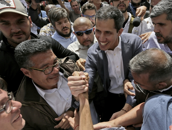 Venezuela's self-declared interim leader Juan Guaido, center, greets supporters after a rally at a public plaza in Las Mercedes neighborhood of Caracas, Venezuela, Saturday, Jan. 29, 2019. Venezuela's political showdown moves to the United Nations where a Security Council meeting called by the United States will pit backers of President Nicolas Maduro against the Trump administration and supporters of Guaido. (AP Photo/Fernando Llano)