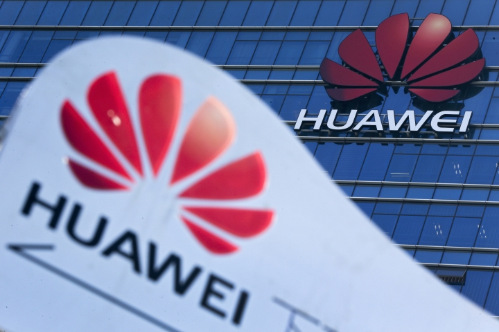 FILE - This Tuesday, Dec. 18, 2018, file photo, shows company signage on display near the Huawei office building at its research and development center in Dongguan, in south China's Guangdong province. A federal indictment accuses Huawei of stealing trade secrets from T-Mobile, in the form of a robot designed to automatically test phones for problems. (AP Photo/Andy Wong, File)