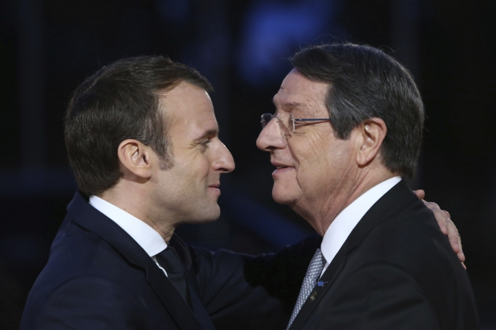"""Cypriot President Nicos Anastasiades, right, welcomes his French counterpart Emanuel Macron during the south EU summit in capital Nicosia, Cyprus, Tuesday, Jan. 29, 2019. Cyprus is hosting the leaders of France, Portugal, Malta, Greece, Spain and Italy for the fifth """"Med 7"""" summit. The leaders will discuss issues including Brexit, migration _ which is of particular concern to these front-line states _ and the European Union's energy security. (AP Photo/Petros Karadjias)"""