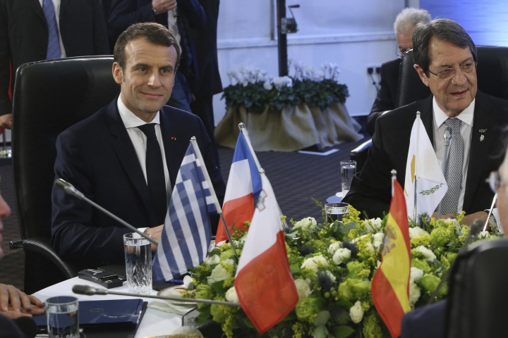 """Cypriot President Nicos Anastasiades, right, and French President Emanuel Macron attend a south EU summit in capital Nicosia, Cyprus, Tuesday, Jan. 29, 2019. Cyprus is hosting the leaders of France, Portugal, Malta, Greece, Spain and Italy for the fifth """"Med 7"""" summit. The leaders will discuss issues including Brexit, migration _ which is of particular concern to these front-line states _ and the European Union's energy security. (AP Photo/Petros Karadjias)"""