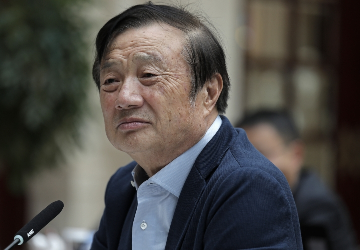"In this Tuesday, Jan. 15, 2019, photo, Ren Zhengfei, founder and CEO of Huawei, listens to reporters questions during a round table meeting with the media in Shenzhen city, south China's Guangdong province. China's government called on Washington on Tuesday to ""stop the unreasonable crackdown"" on Huawei following the tech giant's indictment in the U.S. on charges of stealing technology and violating sanctions on Iran. (AP Photo/Vincent Yu)"