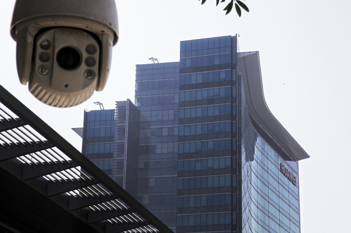 In this Dec. 18, 2018, photo, a surveillance camera is mounted near the Huawei headquarters in Shenzhen in south China's Guangdong province. The U.S. Justice Department unsealed criminal charges Monday, Jan. 28, 2019 against Chinese tech giant Huawei, a top company executive and several subsidiaries, alleging the company stole trade secrets, misled banks about its business and violated U.S. sanctions. (AP Photo/Andy Wong)