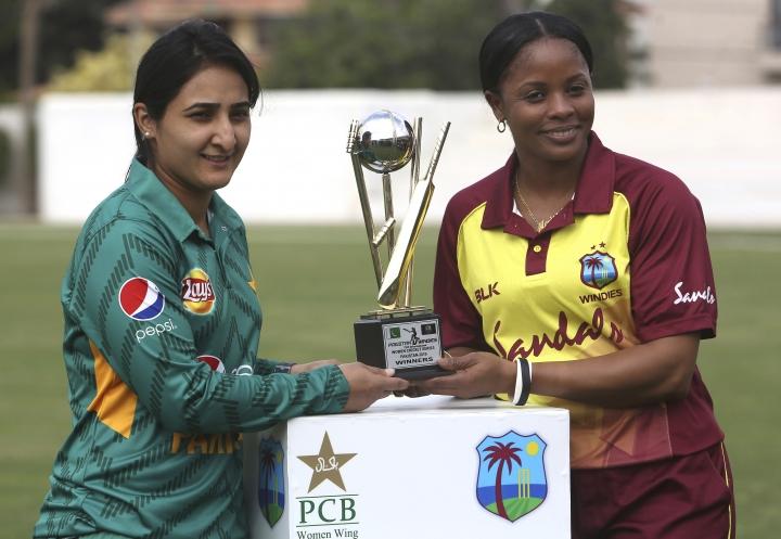 West Indies captain Merissa Aguilleira, right, and Pakistan's captain Bismah Maroof pose with the trophy at Southend Club in Karachi, Pakistan, Wednesday, Jan. 30, 2019. West Indies team arrived in Pakistan after almost 15 years for international cricket as it plays three Twenty20 internationals at Karachi. (AP Photo/Fareed Khan)