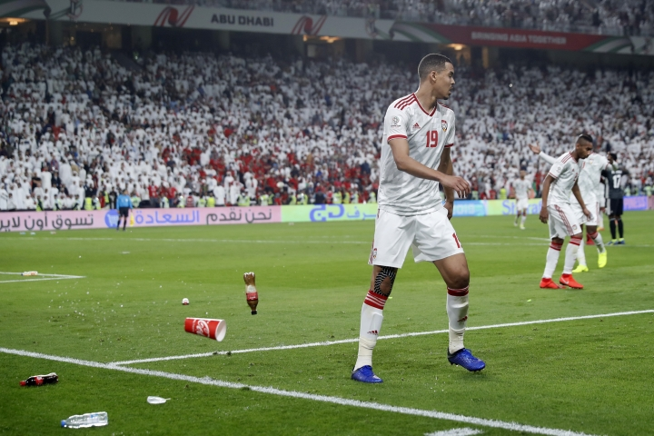 Bottles are thrown on the field by United Arab Emirates fans after Qatar's forward Hasan Al Haydos scores his side's third goal during the AFC Asian Cup semifinal soccer match between United Arab Emirates and Qatar at Mohammed Bin Zayed Stadium in Abu Dhabi, United Arab Emirates, Tuesday, Jan. 29, 2019. (AP Photo/Hassan Ammar)