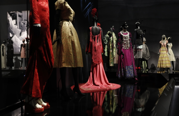 A selection of Christian Dior designs by Marc Bohan and John Galliano for the House of Dior, on display during a press preview of the largest exhibition in the United Kingdom of the Paris based fashion House of Dior at the V&A Museum in London, Wednesday, Jan. 30, 2019. Billed as the largest and most comprehensive exhibition ever staged in Britain on the revered fashion house, the exhibition traces the impact of Dior over seven decades and showcases dozens of spectacular couture gowns. (AP Photo/Alastair Grant)