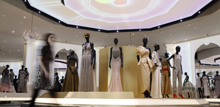 Designs for Christian Dior by Maria Grazia Chiuri Haute couture Spring/Summer 2018, known as J'Adore Dress silk and sequins on display during a press preview of the largest exhibition in the United Kingdom of the Paris based fashion House of Dior at the V&A Museum in London, Wednesday, Jan. 30, 2019. Billed as the largest and most comprehensive exhibition ever staged in Britain on the revered fashion house, the exhibition traces the impact of Dior over seven decades and showcases dozens of spectacular couture gowns. (AP Photo/Alastair Grant)