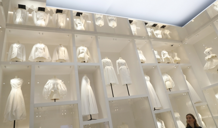 A selection of Christian Dior designs on display during a press preview of the largest exhibition in the United Kingdom of the Paris based fashion House of Dior at the V&A Museum in London, Wednesday, Jan. 30, 2019. Billed as the largest and most comprehensive exhibition ever staged in Britain on the revered fashion house, the exhibition traces the impact of Dior over seven decades and showcases dozens of spectacular couture gowns. (AP Photo/Alastair Grant)