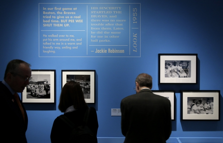 "In this Tuesday, Jan. 29, 2019 photo, photographs of and information about Brooklyn Dodgers baseball player Jackie Robinson are displayed at the exhibit ""In the Dugout with Jackie Robinson: An Intimate Portrait of a Baseball Legend"" at the Museum of City of New York in New York. The 100th anniversary of Robinson's birth is celebrated Thursday, Jan. 31, with the opening of the exhibit. (AP Photo/Seth Wenig)"
