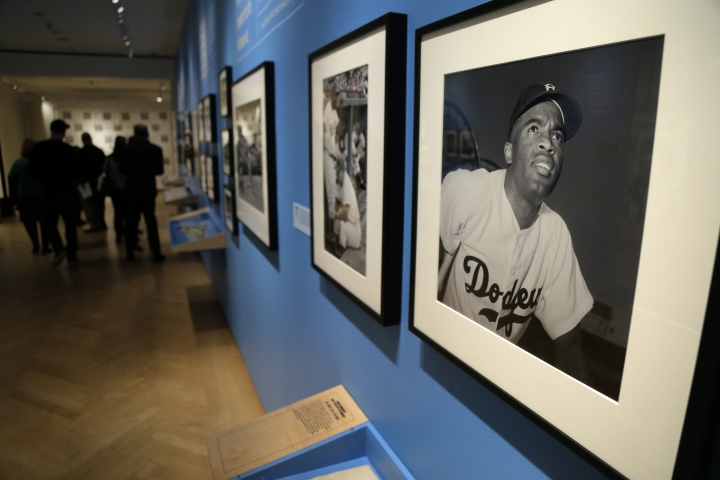 "In this Tuesday, Jan. 29, 2019 photo, photographs of Brooklyn Dodgers baseball player Jackie Robinson are displayed at the exhibit ""In the Dugout with Jackie Robinson: An Intimate Portrait of a Baseball Legend"" at the Museum of City of New York in New York. The 100th anniversary of Robinson's birth is celebrated Thursday, Jan. 31, with the opening of the exhibit. (AP Photo/Seth Wenig)"