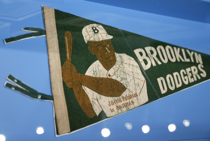 """In this In this Tuesday, Jan. 29, 2019 photo phot, banner with a picture of Brooklyn Dodgers baseball player Jackie Robinson is displayed at the exhibit """"In the Dugout with Jackie Robinson: An Intimate Portrait of a Baseball Legend"""" at the Museum of City of New York in New York. The 100th anniversary of Robinson's birth is celebrated Thursday, Jan. 31, with the opening of the exhibit. (AP Photo/Seth Wenig)"""