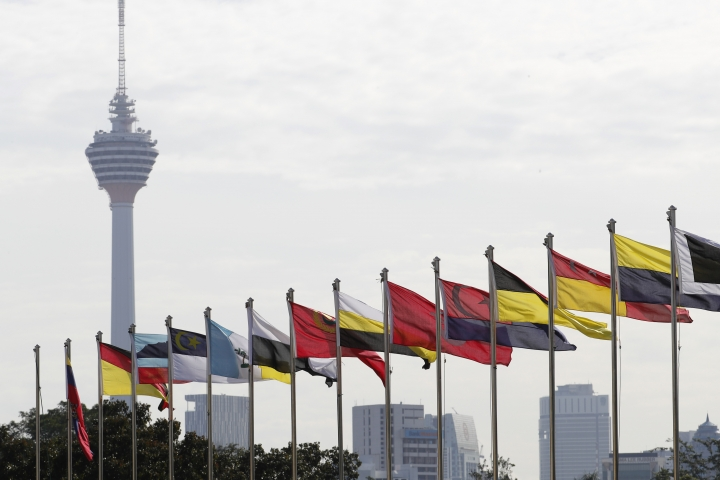 Kuala Lumpur Tower and flags of Malaysian states are seen during a welcome ceremony for King Sultan Abdullah Sultan Ahmad Shah at Parliament House in Kuala Lumpur, Malaysia, Thursday, Jan. 31, 2019. Sultan Abdullah, ruler of central Pahang state, was named Malaysia's new king, replacing Sultan Muhammad V who abdicated unexpectedly after just two years on the throne. (AP Photo/Vincent Thian)