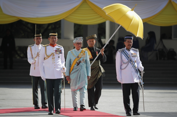 Malaysian new King Sultan Abdullah Sultan Ahmad Shah, center, inspects an honor guard during his welcome ceremony at Parliament House in Kuala Lumpur, Malaysia, Thursday, Jan. 31, 2019. Sultan Abdullah, ruler of central Pahang state, was named Malaysia's new king, replacing Sultan Muhammad V who abdicated unexpectedly after just two years on the throne. (AP Photo/Vincent Thian)