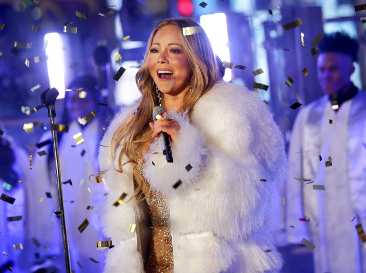 FILE - In this Dec. 31, 2017 file photo, Mariah Carey performs at the New Year's Eve celebration in Times Square in New York. Carey, one of the world's most celebrated artists, is performing in Saudi Arabia for the first time, but there's a growing chorus of Saudi women calling on her to cancel the concert in support of detained women's rights activists. Activists say her concert is an attempt by the government to polish its image after the Oct. 2 killing of Saudi critic Jamal Khashoggi inside the Saudi Consulate in Istanbul. (Photo by Brent N. Clarke/Invision/AP, File)