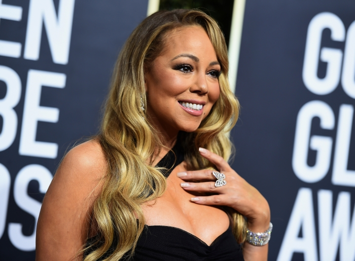 FILE - In this Jan. 7, 2018, file photo, Mariah Carey arrives at the 75th annual Golden Globe Awards at the Beverly Hilton Hotel in Beverly Hills, Calif. Carey, one of the world's most celebrated artists, is performing in Saudi Arabia for the first time, but there's a growing chorus of Saudi women calling on her to cancel the concert in support of detained women's rights activists. Activists say her concert is an attempt by the government to polish its image after the Oct. 2 killing of Saudi critic Jamal Khashoggi inside the Saudi Consulate in Istanbul. (Photo by Jordan Strauss/Invision/AP, File)
